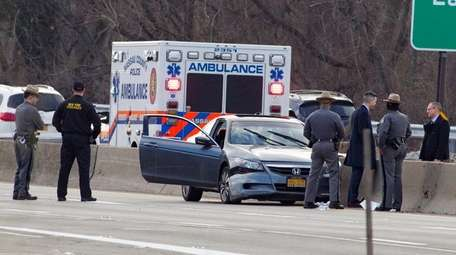 New York State Police investigate an accident in