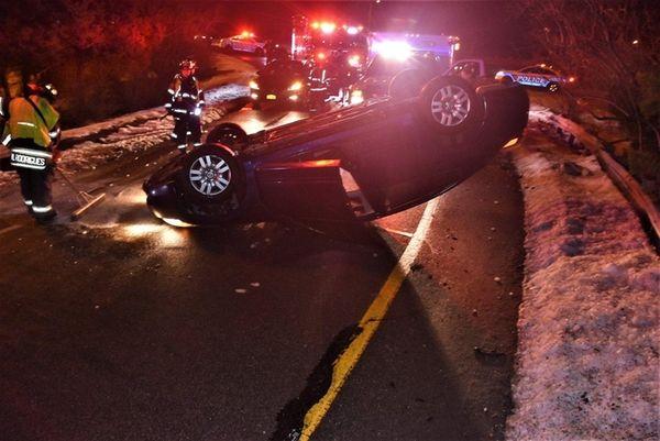 Rescue personnel respond to a single-car crash Wednesday