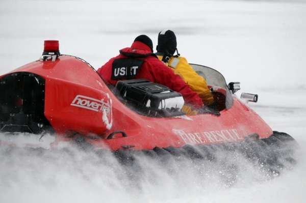 Rescue crews use a hovercraft to search the