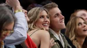 Genie Bouchard, left, poses for photographs with her