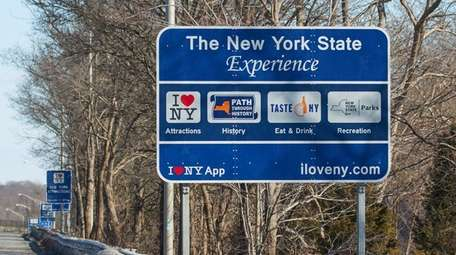 The New York Experience sign on the Long