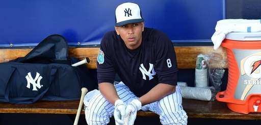 Alex Rodriguez in the dugout during spring training