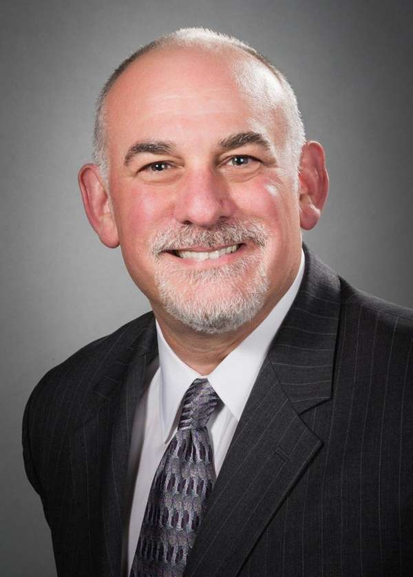 Dr. Robert M. Galler of East Setauket has