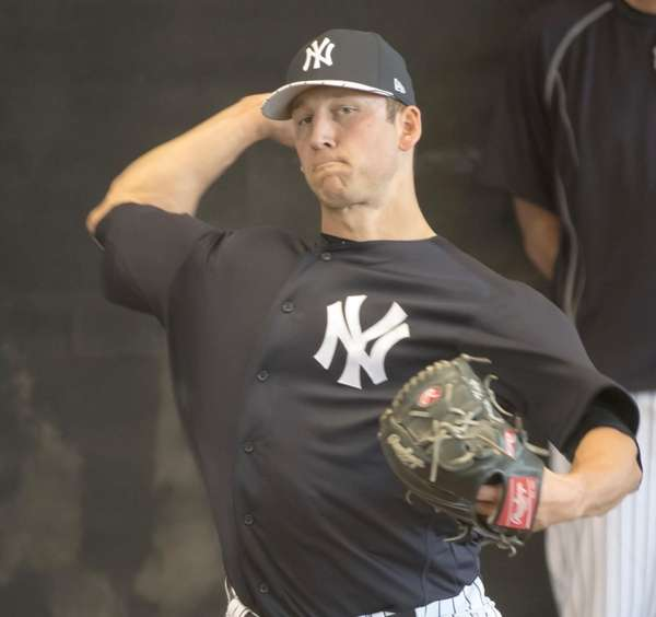 New York Yankees pitcher James Kaprielian throws in