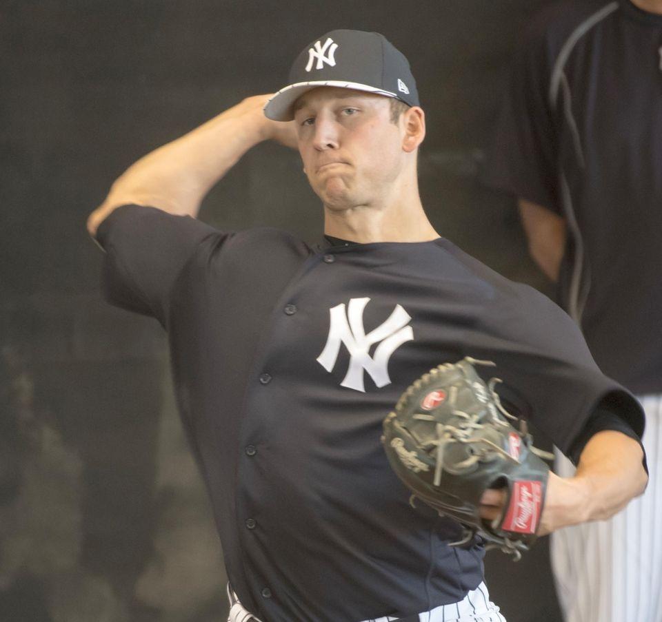New York Yankees pitcher James Kaprielian throws in