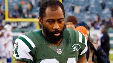 Darrelle Revis of the New York Jets walks