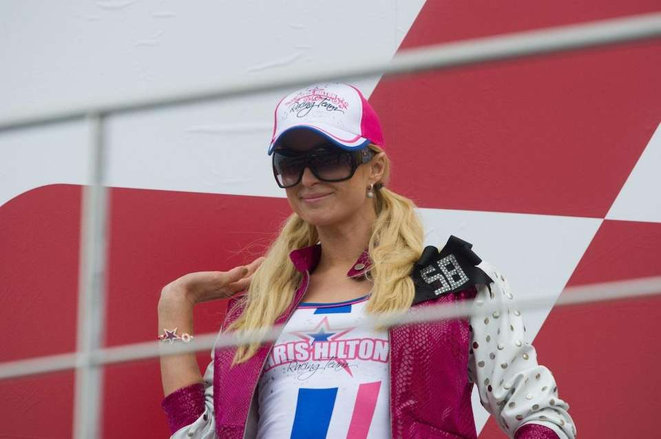 Paris Hilton poses on the podium during the