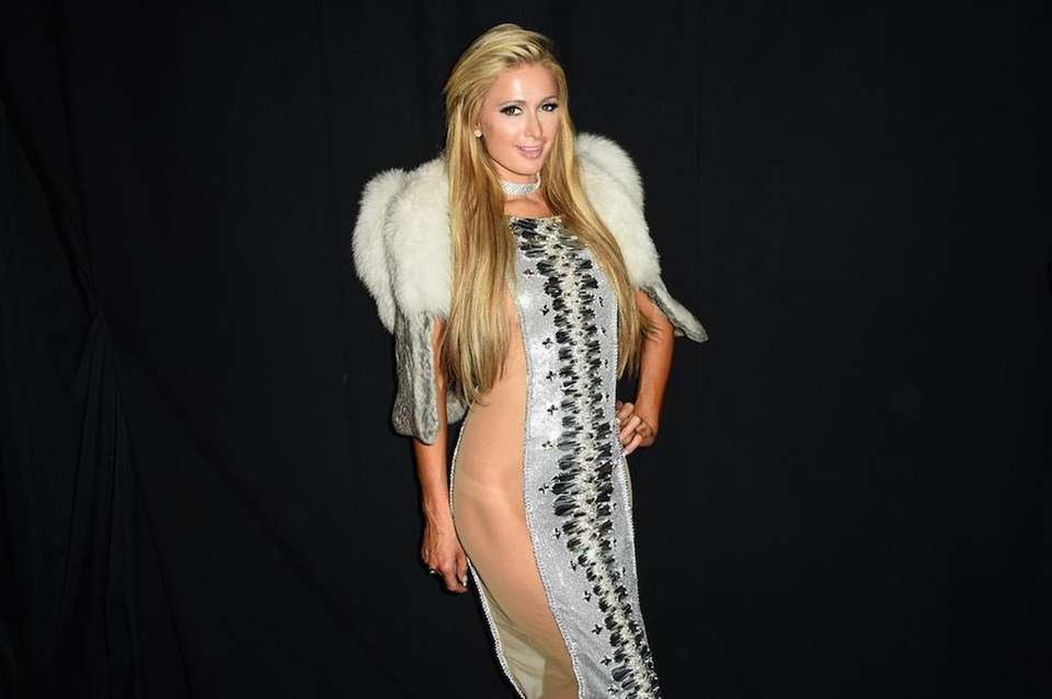 Paris Hilton poses backstage for the The Blonds