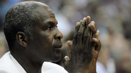 Former Knick Charles Oakley watches from courtside seats