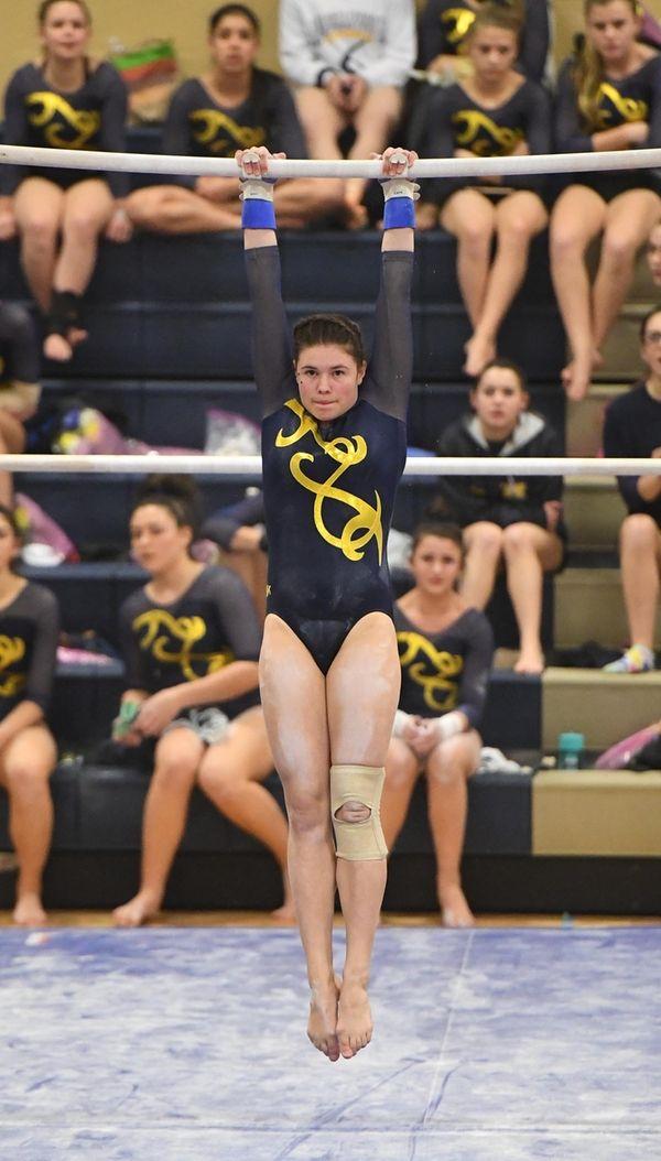 Gillian Murphy of Massapequa competes on the uneven