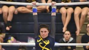 Gillian Murphy of Massapequa competes on the uneven