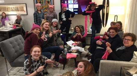 Pierson Feminists United club members and advisors knit
