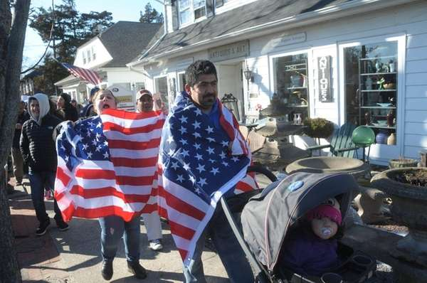 People march along Montauk Highway in Hampton Bays