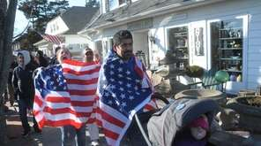 People march along Montauk Highway in Hampton Bays