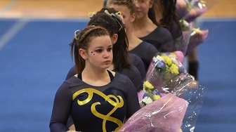 Gymnasts from Massapequa are introduced at the beginning