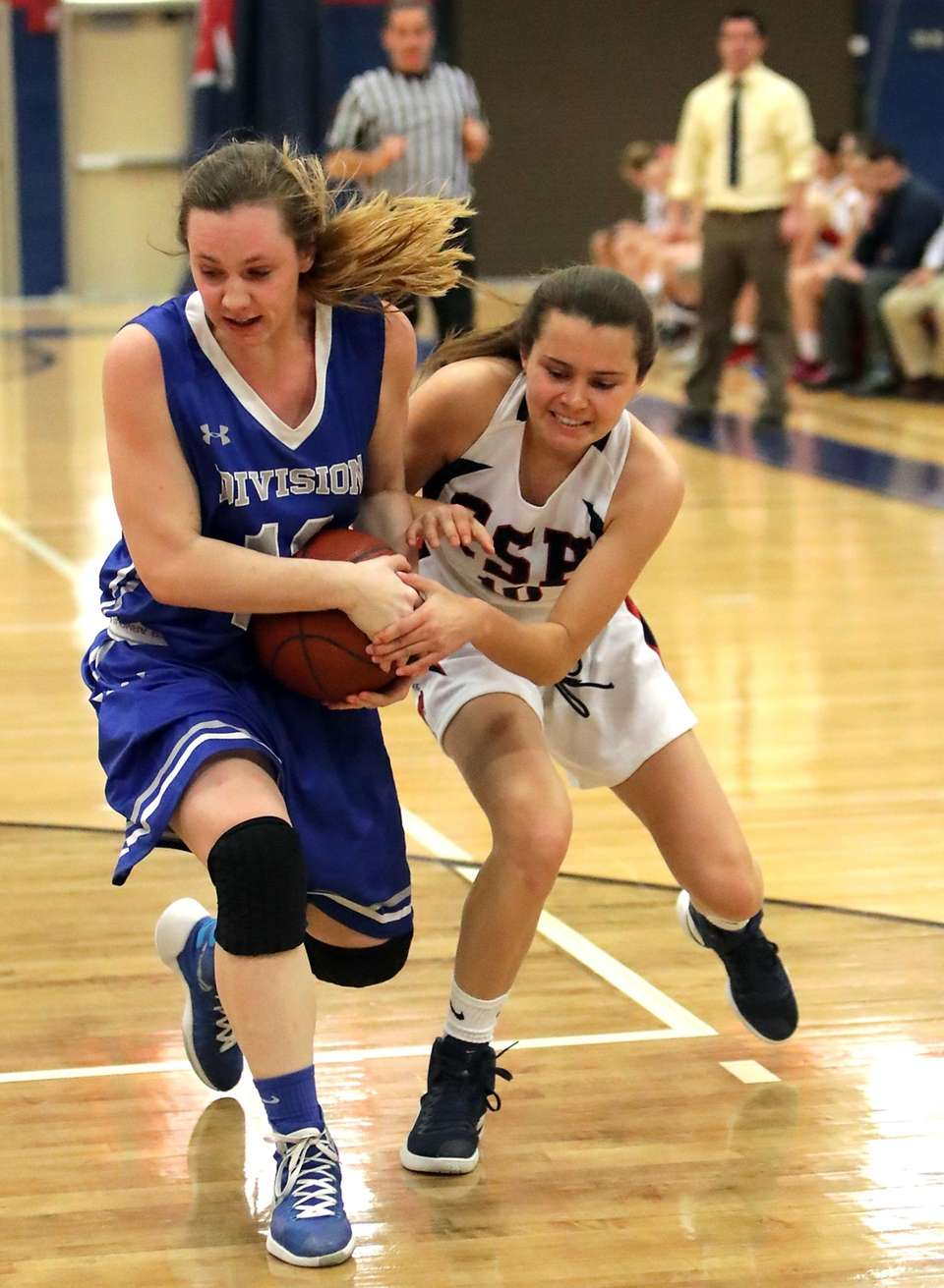 Division's Erin McCauley (12) strips the ball from