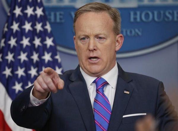 White House Press secretary Sean Spicer points as