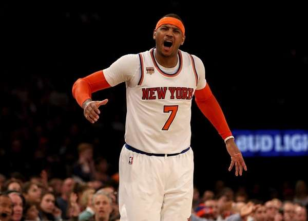 Carmelo Anthony of the New York Knicks reacts after