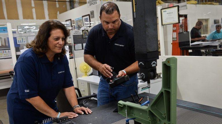 President Teresa Ferraro watches senior lab technician Manny