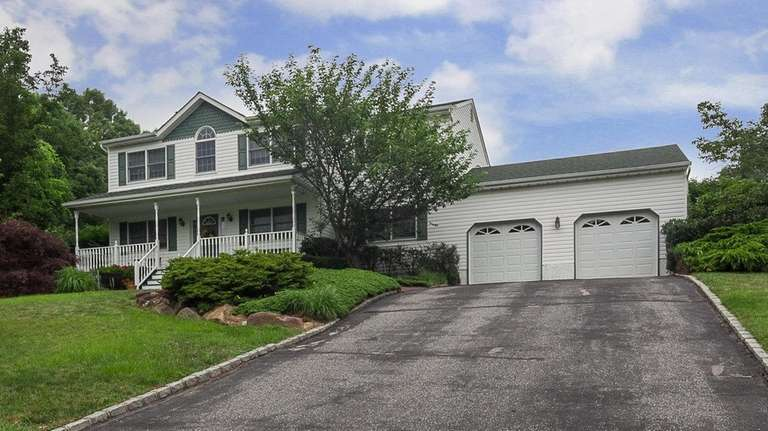 The garage, accessed from this Manorville home's den,