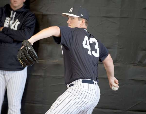 New York Yankees pitcher Adam Warren tosses in