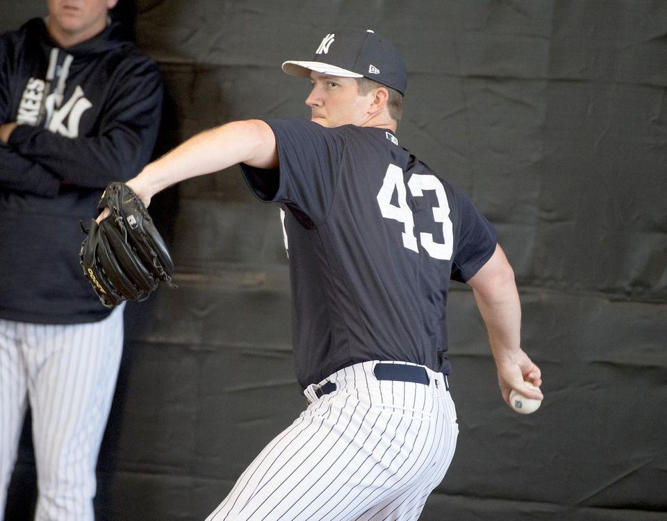 New York Yankees pitcher Adam Warren tosses in