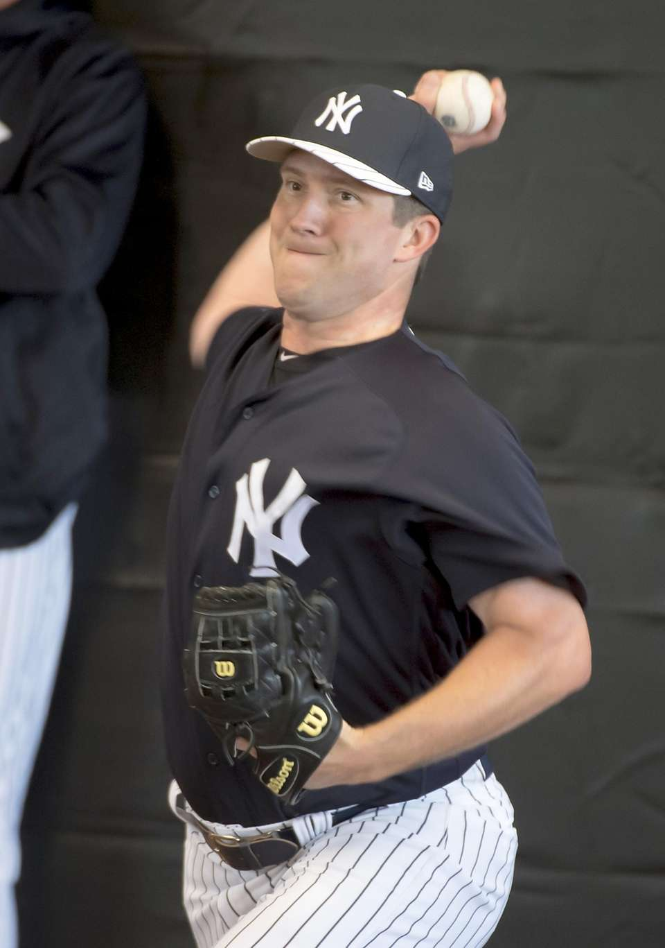 New York Yankees pitcher Adam Warren throws in