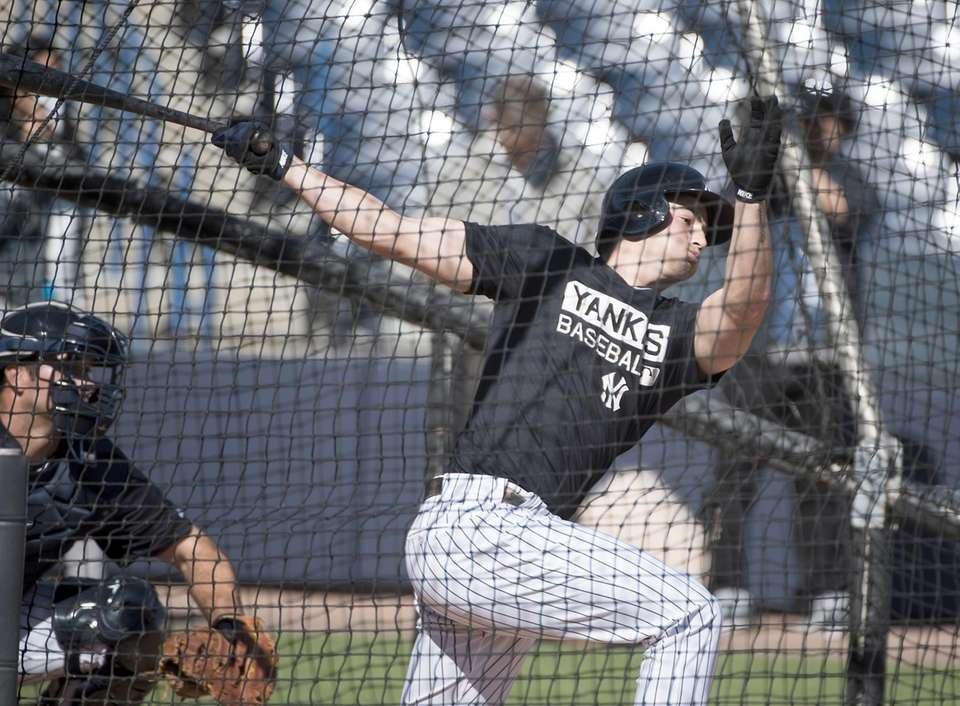 New York Yankees' Tyler Wade in mid-swing during