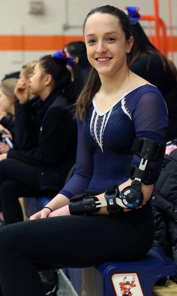 Miranda Lund, who injured her left elbow, watches