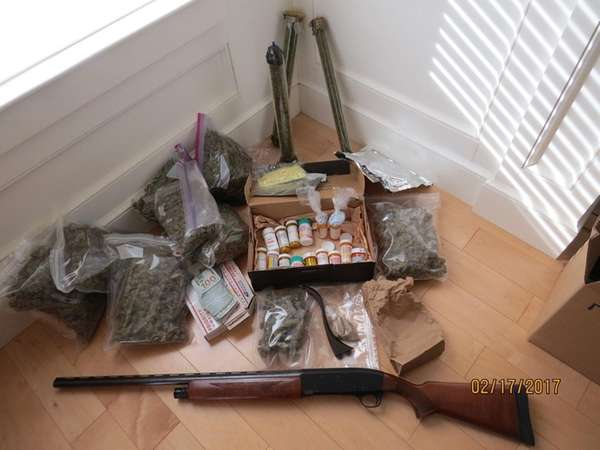 A gun and drugs that were seized by
