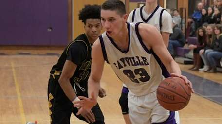 Sayville's Joey Harclerode, #23, drives towards the basket
