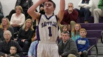 Sayville's Joey Mas, #1, shoots a three-pointer late