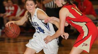 Hauppauge's Katie Murphy, #24, carries the ball while