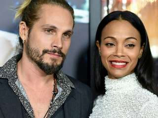 Artist Marco Perego and actress Zoe Saldana arrive