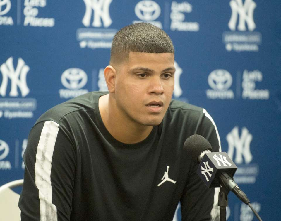New York Yankees' pitcher Kellin Betances holding a
