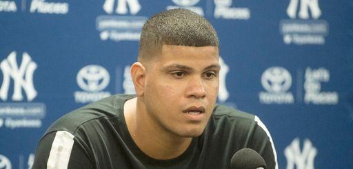 New York Yankees' pitcher Kellin Betances holding a