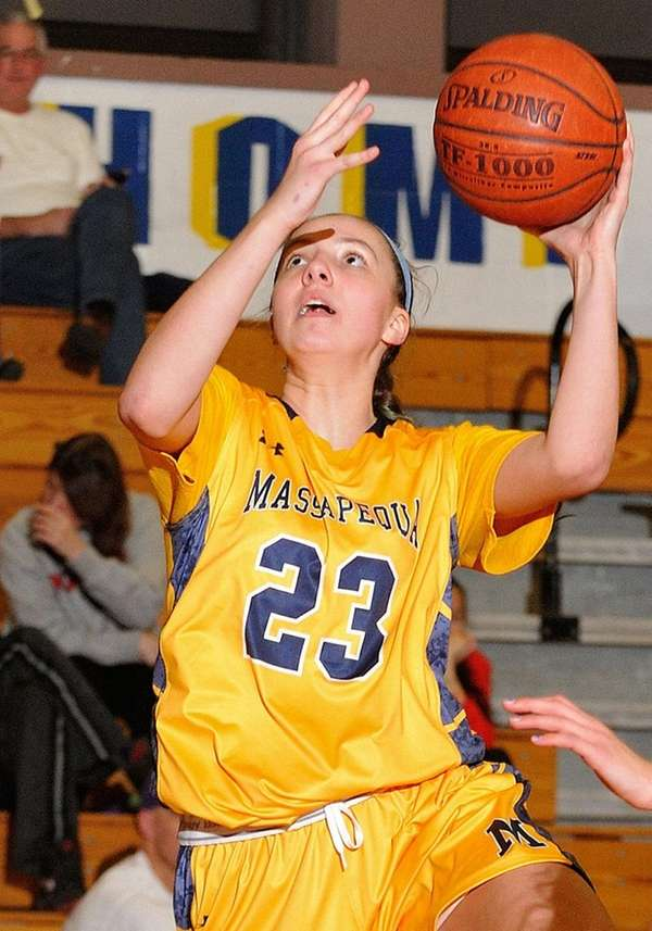 Gabriella Heimbauer #23 of Massapequa scores from beneath