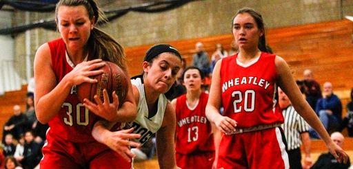 Julia Braito of Wheatley High School battles for