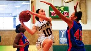 Oyster Bay's Gabriela Treble, center, goes for a