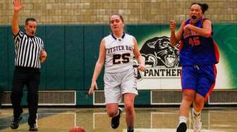 Oyster Bay's Catherine Kelly, #25, drives to the