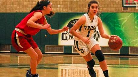 Carle Place's Leah Burden, right, drives to the