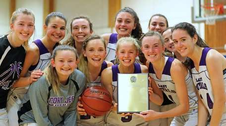 Port Jefferson teammates celebrate with the winning plaque