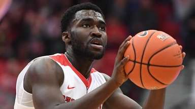 Stony Brook guard UC Iroegbu shoot a free
