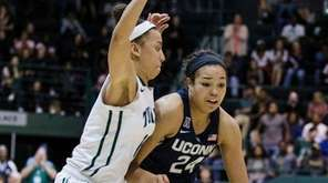 Tulane guard Tene Thompson, left, tries to block