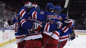 New York Rangers teammates celebrate a goal by