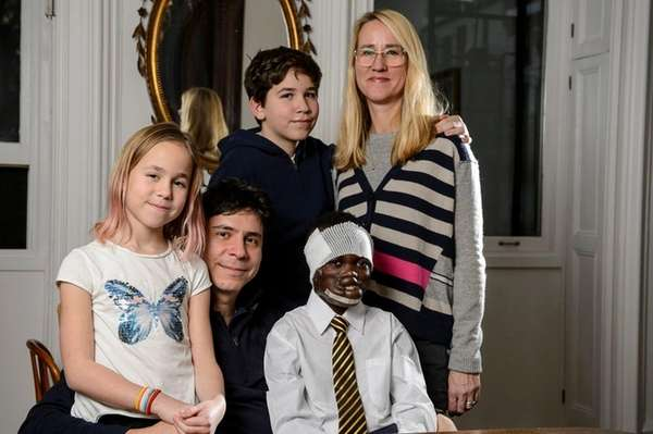 Dunia Sibomana, 9, bottom right, with his host