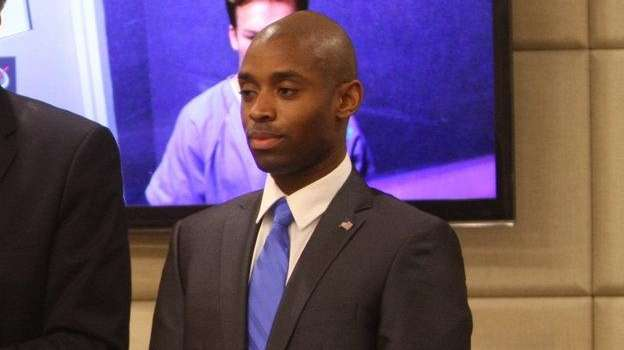 Stanley Wilson II, right, stands with a public