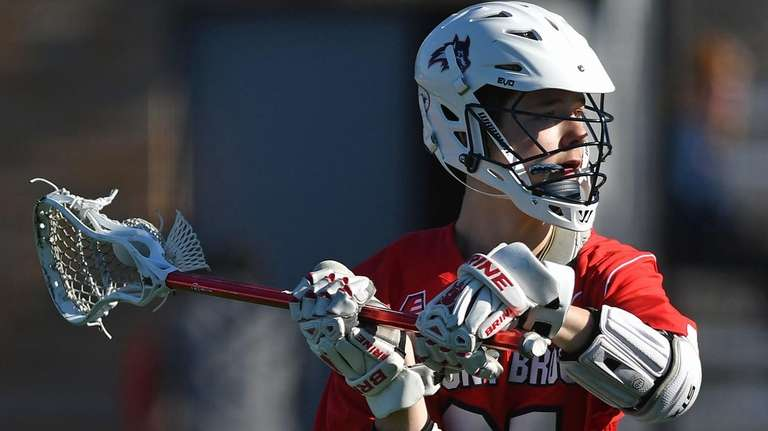 Connor Grippe #21 of Stony Brook makes a