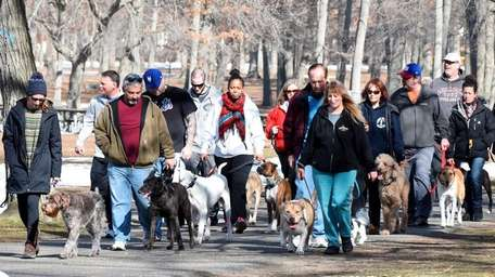 People enjoy a spring-like day at Belmont Lake