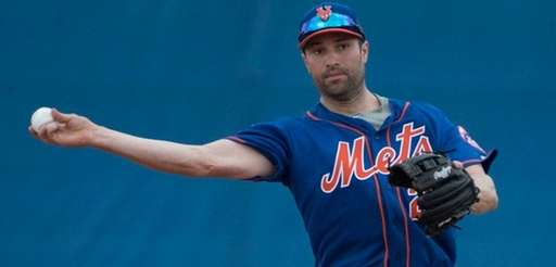 Mets second baseman  Neil Walker makes a throw